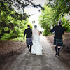 Couple and piper at Achnagairn house Kirkhill highlands