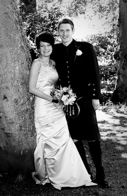 Wedding photograph of couple at Ness Islands Inverness Lynn Robinson of Black Isle Photography which coveres the Highlands including Inverness